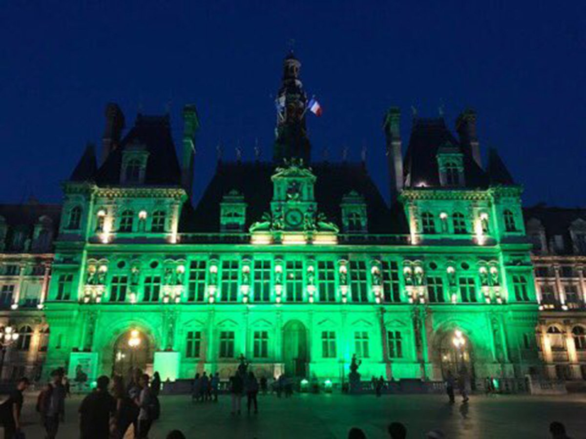 World landmarks turn green in protest at Donald Trump pulling US from Paris accord