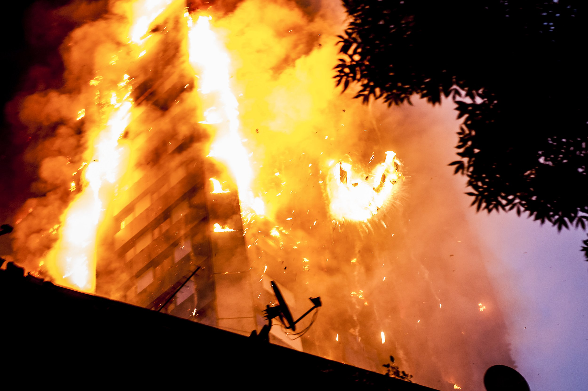 Falling burning debris at the scene of the huge fire at Grenfell tower block in White City, London. The blaze engulfed the 27-storey building with 200 firefighters attending the scene. There were reports of people trapped in the building (Picture: Guilhem Baker/LNP)