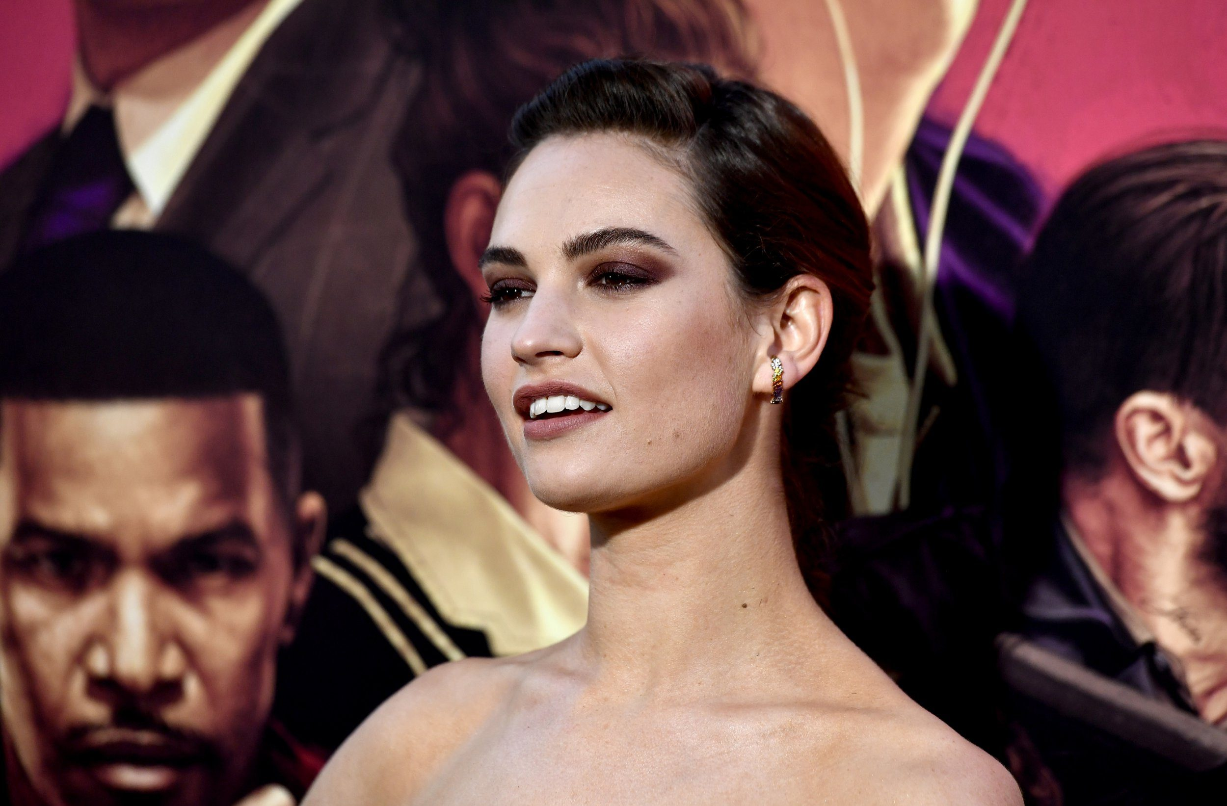 Lily James refuses to let Downton Abbey movie rumours go away as she coyly hints she's involved