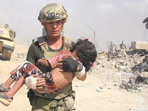 Video emerges of hero running through gunfire to rescue girl trapped by Isis