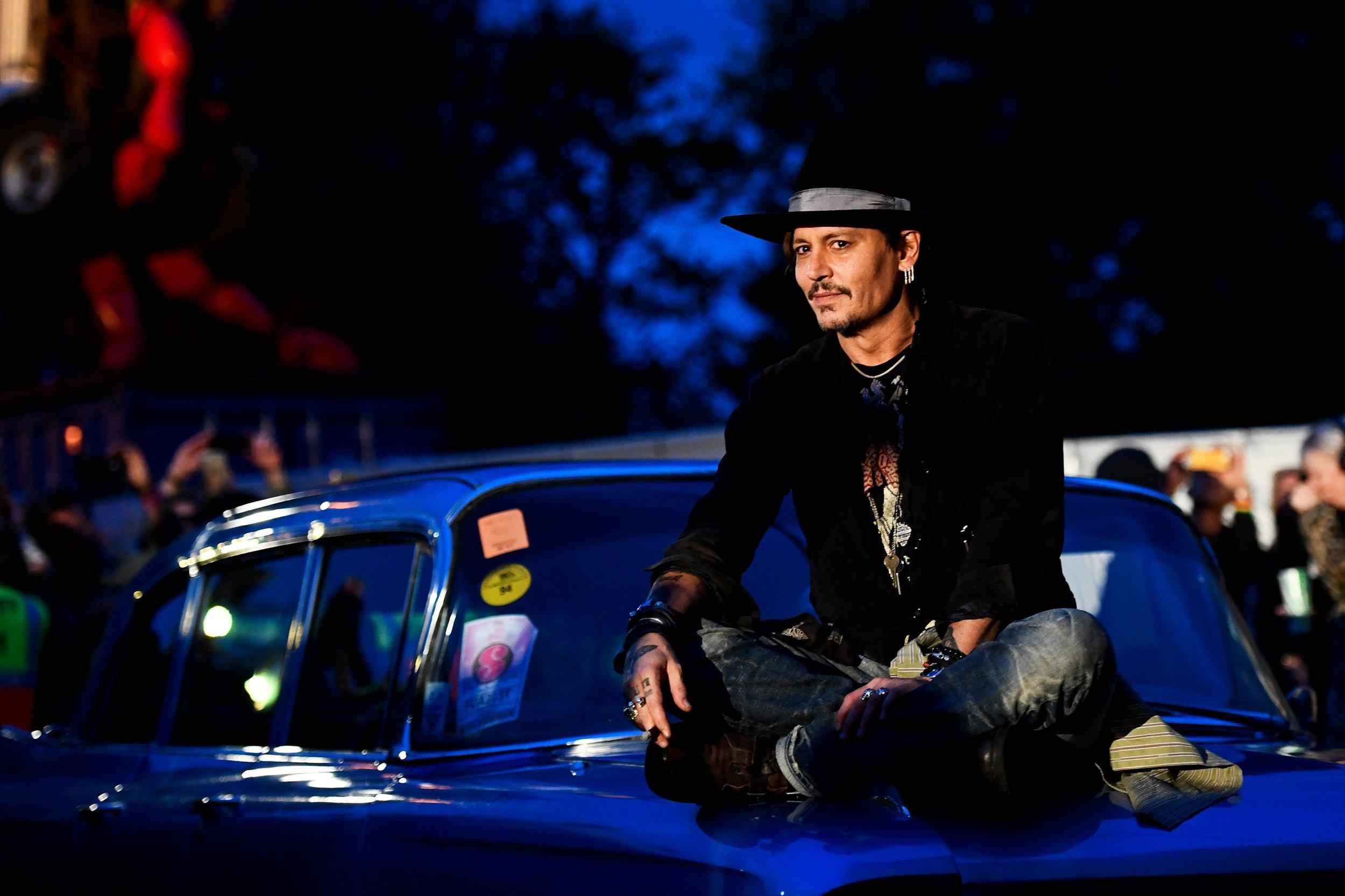 Johnny Depp pops up at Glastonbury, talks about assassinating Donald Trump