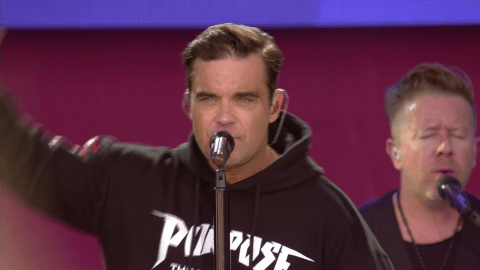 Robbie Williams left unable to sing Angels at One Love Manchester as crowd take over for him