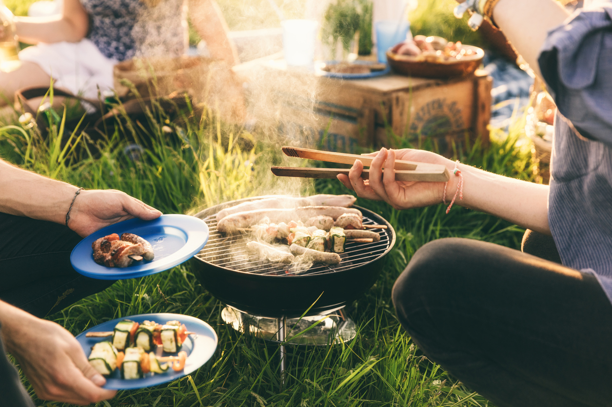 Plate full of grilled food, barbecue with friends
