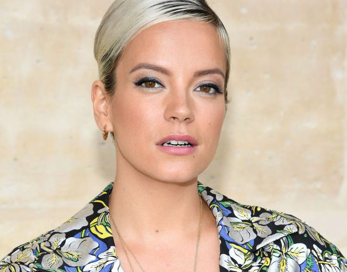 Lily Allen claims she was 'sexually harassed' as she hints at taking legal action agains 'a***hole tormentor'