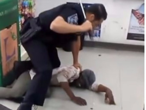 Police officer filmed repeatedly beating homeless woman as she begs for mercy