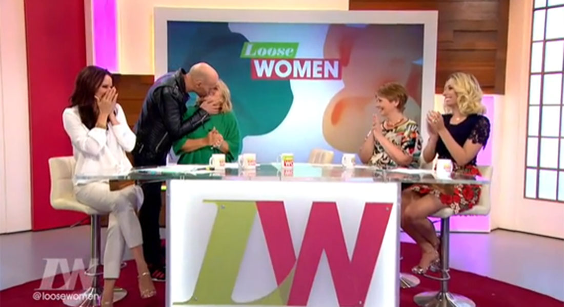 Luke Goss follows his brother on Loose Women as he plants a smacker on Linda Robson