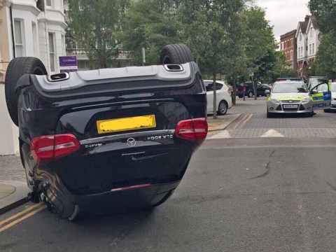 Mystery over how car ended up on its roof on side of road