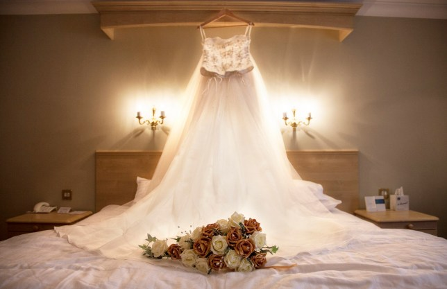 wedding dress and bed