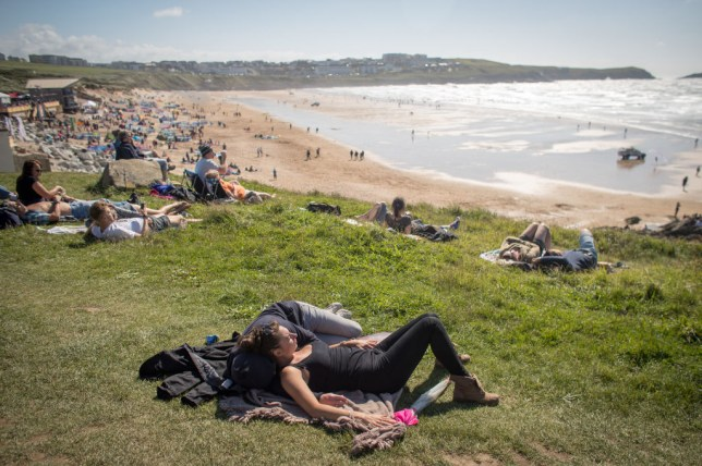 people relaxing by the beach at boardmasters festival