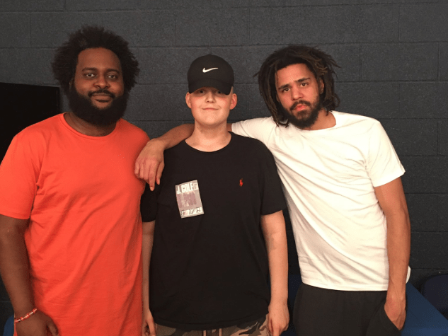 J. Cole surprises young fan diagnosed with rare cancer by offering signed trainers backstage