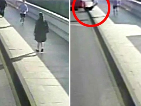 Man arrested after woman was pushed into path of bus on Putney Bridge