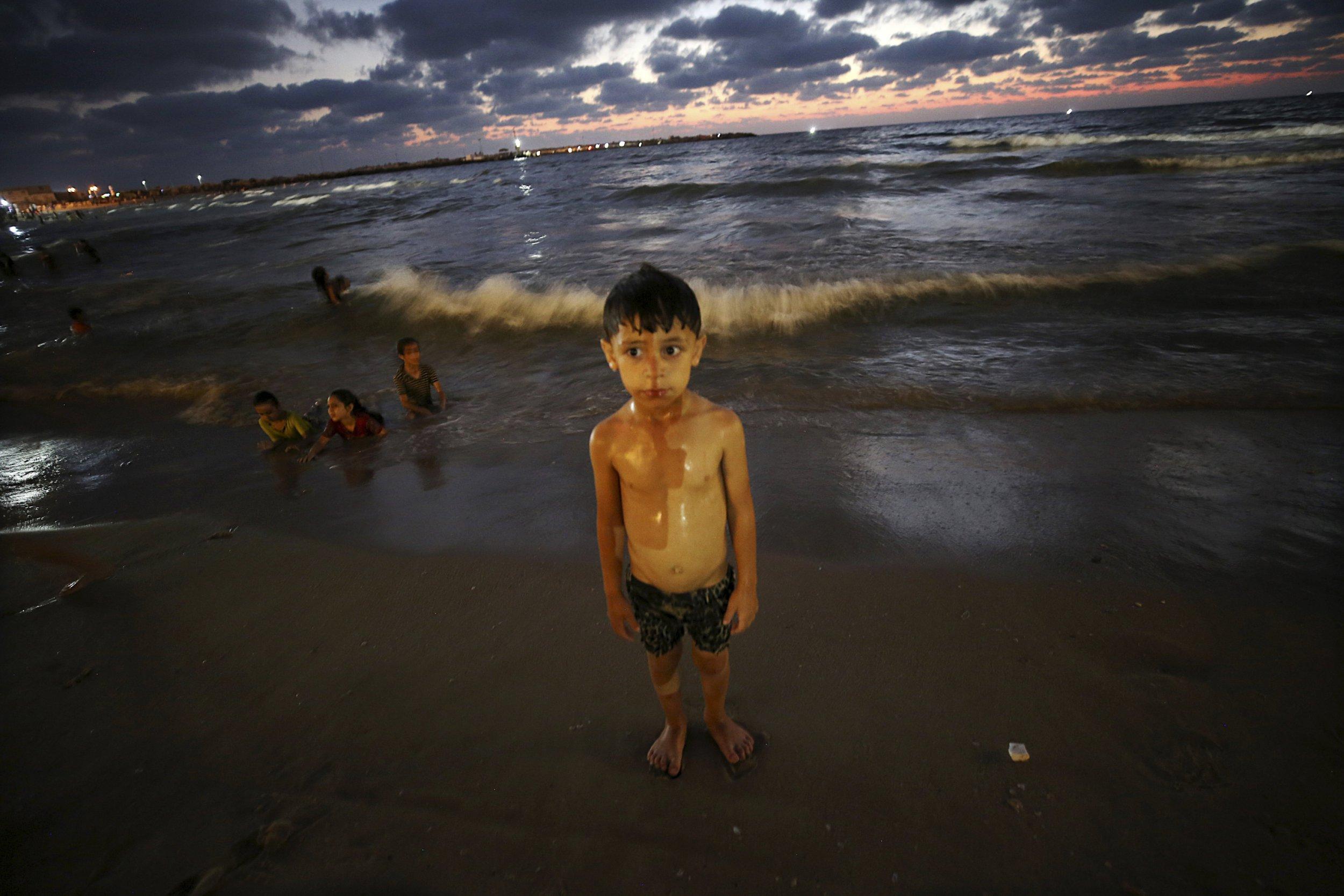 Palestinian children play in raw sewage on Gaza City's beaches
