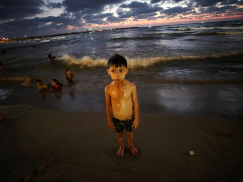 Palestinian children play in raw sewage on Gaza City's beaches