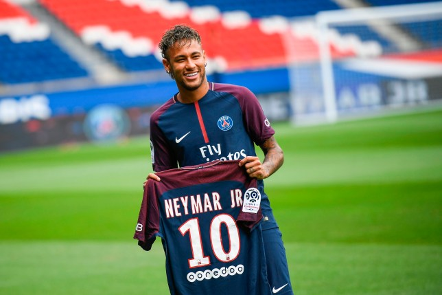 625306202c7 Neymar held up his new number 10 shirt at the Parc des Princes earlier  today (Picture  Getty)