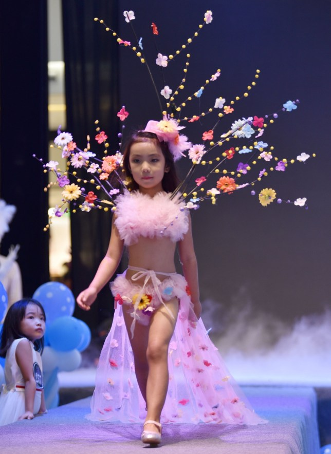 Children walk in Victoria's Secret-style lingerie during a fashion show at  a shopping mall in Chengdu city (Picture: Rex/ImagineChina)