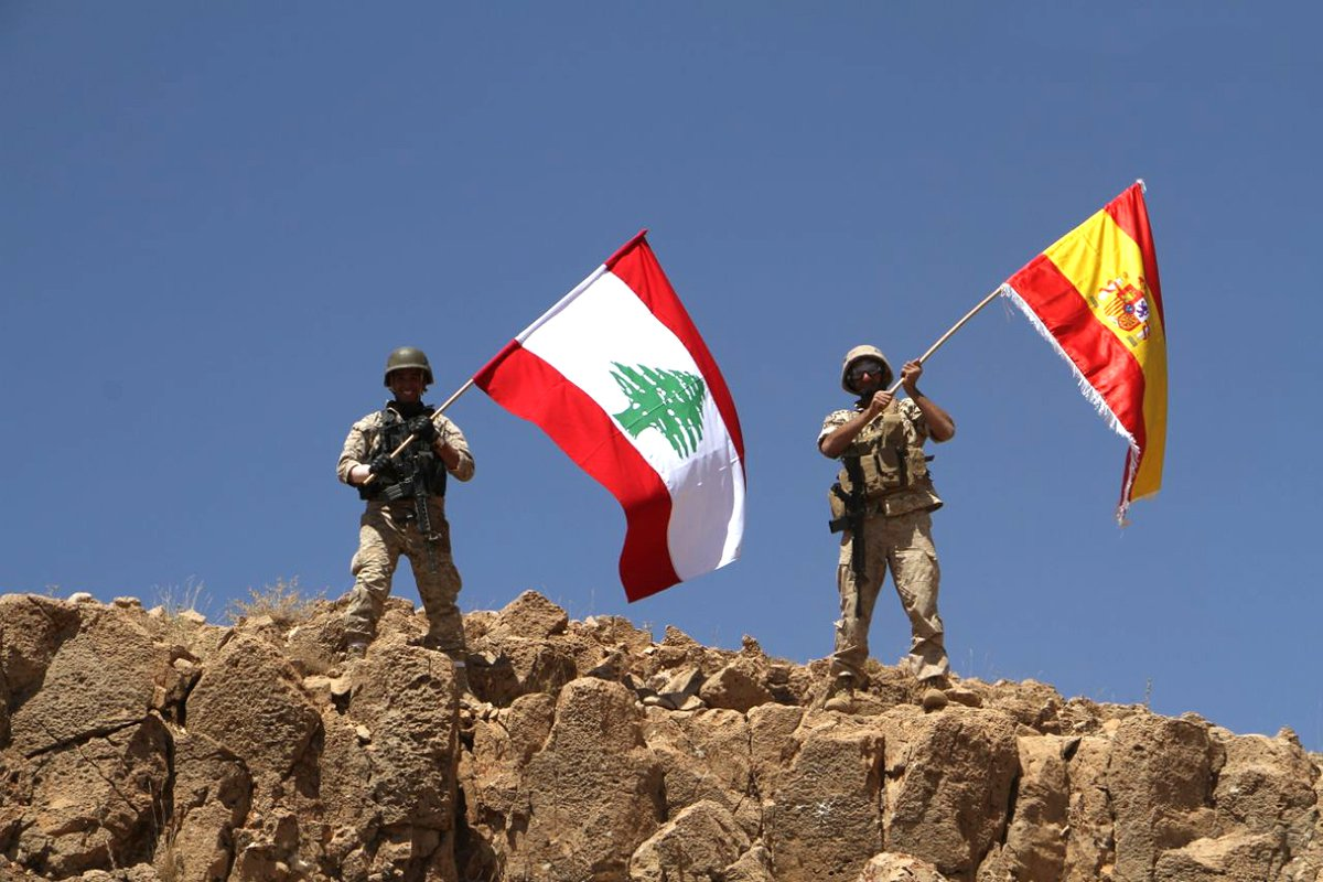 Army fighting Isis raises Spanish flag for Barcelona on captured hilltop