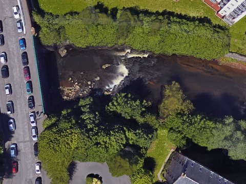 Footballer rescued after falling into river during night out