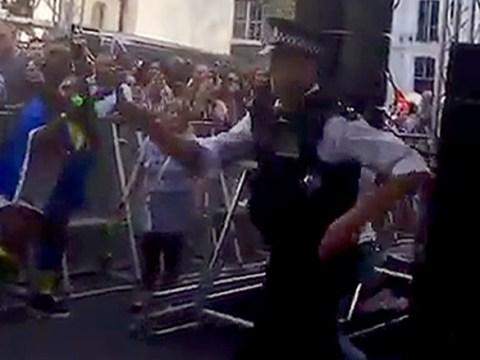 Dancing policeman shakes it up at Notting Hill carnival