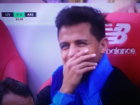 Arsenal fans turn on Alexis Sanchez after he's spotted 'smirking' on bench during Liverpool capitulation