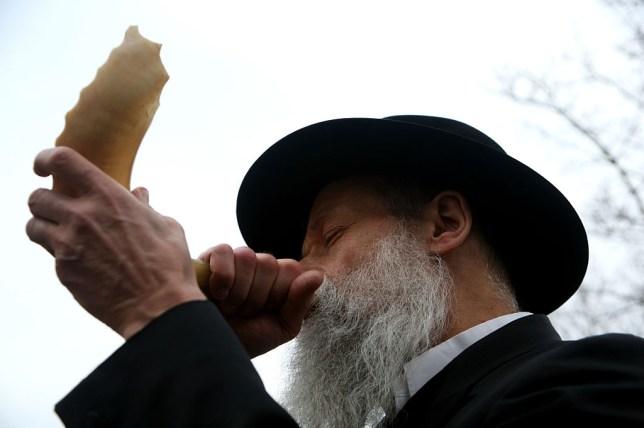 A Rabbi blowing the shofar on Rosh Hashanah