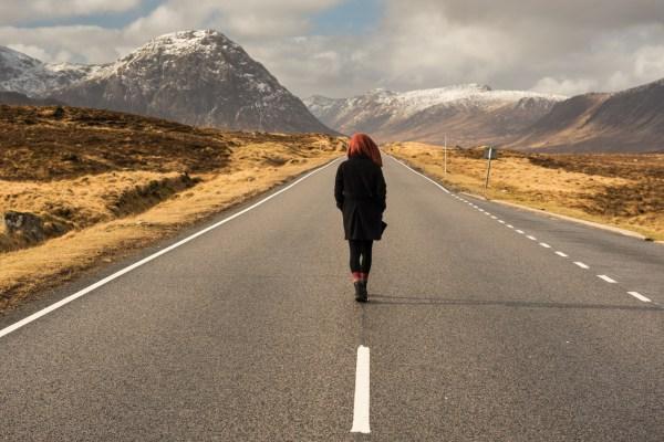 Landscape of someone walking in Glen Coe