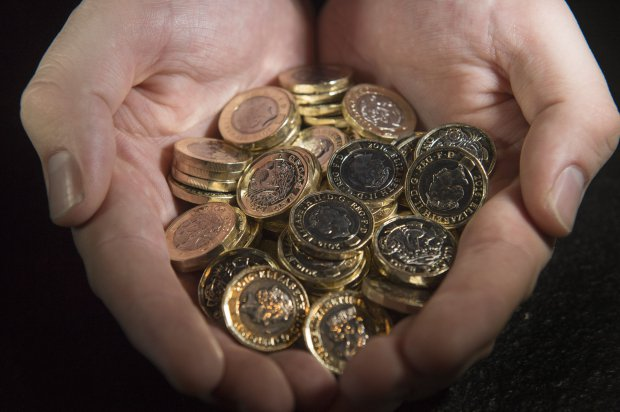 When do the old pound coins go out of circulation?