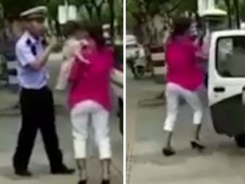 Police officer 'body slams' woman on pavement as she carries young child
