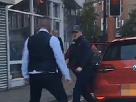 Massive fight breaks out in middle of road after racegoers spit on man's car