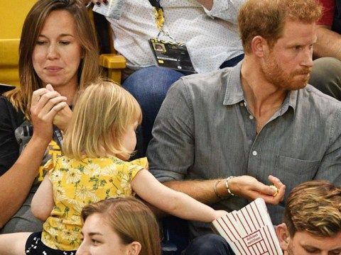 Toddler commits treason by stealing Prince Harry's popcorn
