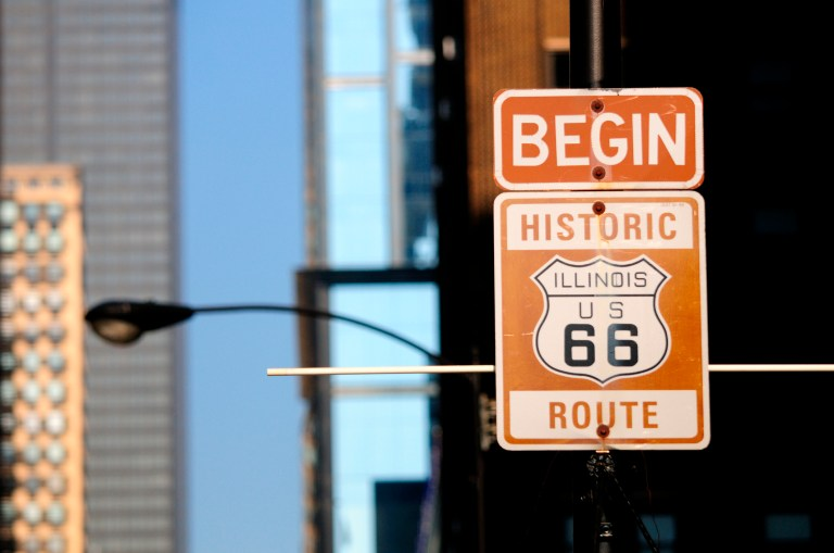 Signs commemorating the start of the famous U.S. Route 66. While the route no longer exists parts of the Mother Road are still in existence and or are recognized with markers and signs. This particular street sign is properly located on Adams Street just west of and in front of the Art Institute which correctly fixes the actual eastern terminal point of the famous American highway which ran from Chicago to Los Angeles. Previous signs that were posted incorrectly on Jackson Blvd. were removed. Chicago, Illinois.