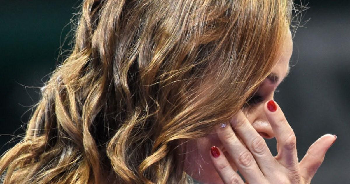 Tennis legend Martina Hingis wipes away tears after ending career