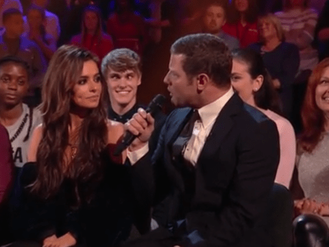 Man sitting behind Cheryl on The X Factor steals show with funny faces