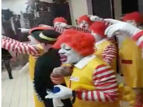 Fifteen Ronald McDonalds chant 'You're shit, you know you are' in assault on Burger King