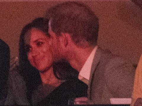 Prince Harry and Meghan Markle have first public kiss during Invictus Games closing ceremony