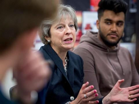 Theresa May challenged by black student over stop and search