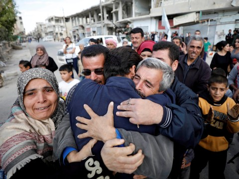 Syrians held hostage by Isis applauded as they return home