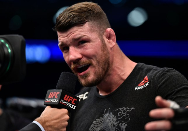 Michael Bisping speaks into the mic after a fight