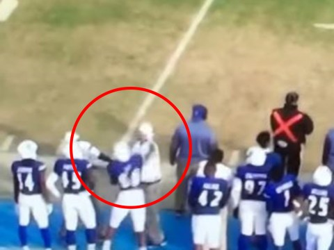 Football player knocks out coach during argument on sidelines