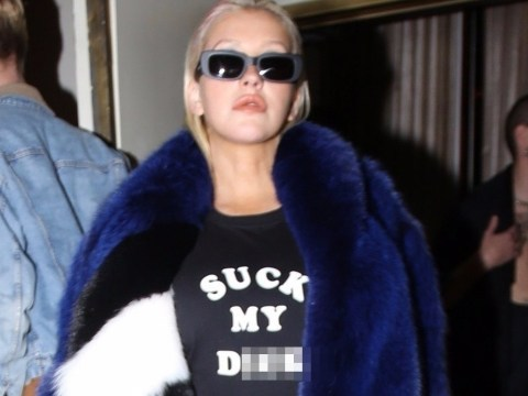 Suck your what?! Christina Aguilera wears bold jumper to fancy dinner