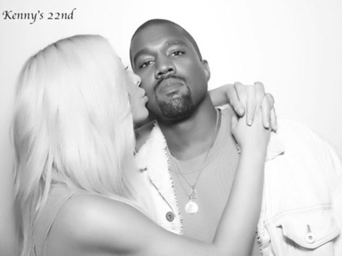 Kim Kardashian and Kanye West in rare romantic snap as she plants a kiss on her husband's cheek
