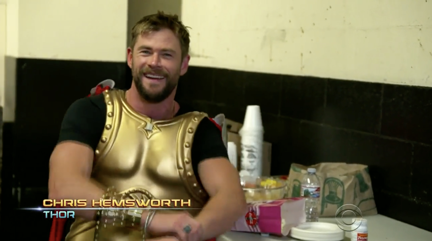 Watch Chris Hemsworth and the Thor: Ragnarok cast crash a screening for a live rendition of the movie