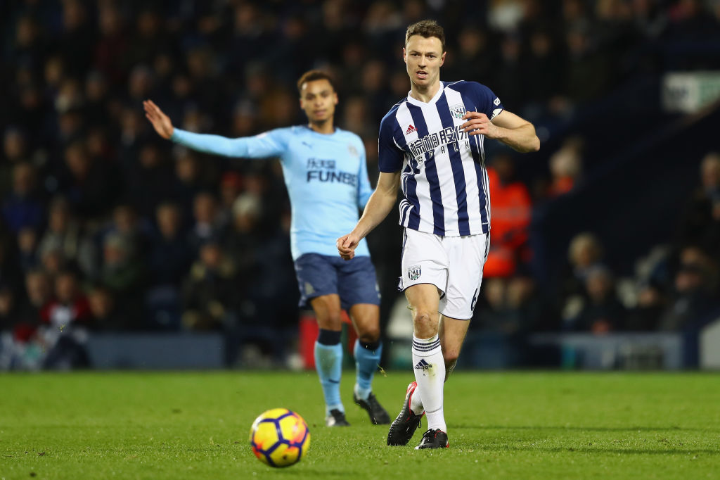 Jonny Evans strides forwards with the ball and passes