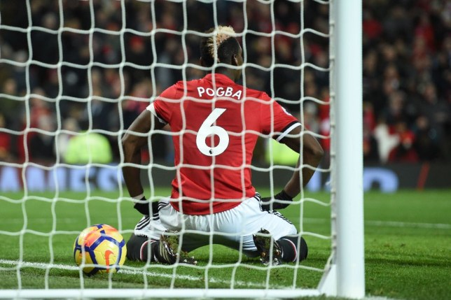Manchester United's French midfielder Paul Pogba reacts after his effort is disallowed