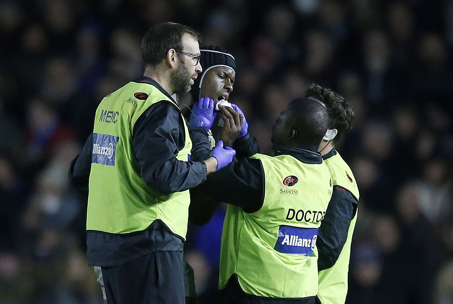 **Image outside of subscription deal, fees apply** Mandatory Credit: Photo by Matthew Impey/REX/Shutterstock (9254753x) Maro Itoje of Saracens is tended to by 3 medical staff after injuring his face in the 2nd half Harlequins v Saracens, Aviva Premiership, Rugby Union, The Stoop, London, UK - 03/12/2017