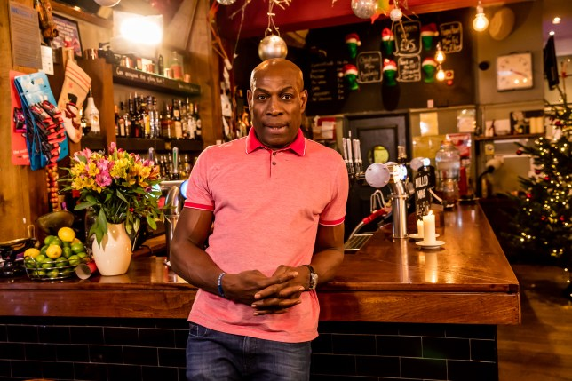Frank Bruno leans against the bar
