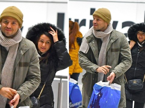 Home for the holidays! Michelle Keegan and Mark Wright return with wedding rings on