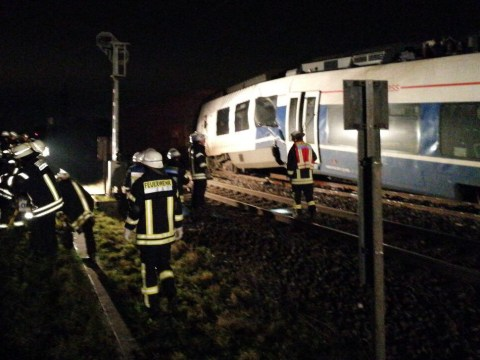 Several injured after passenger train hits freight train in Germany