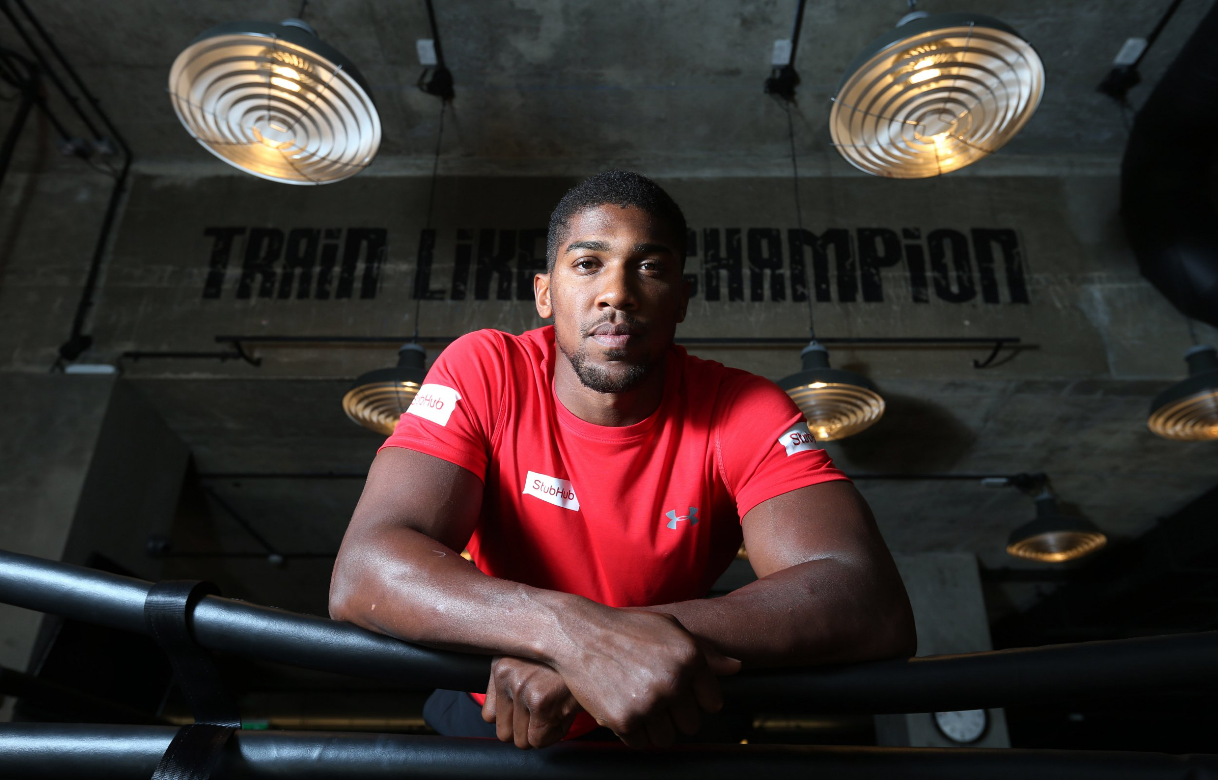 Anthony Joshua leans on the ropes