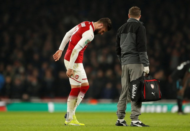 Olivier Giroud hobbles off the pitch