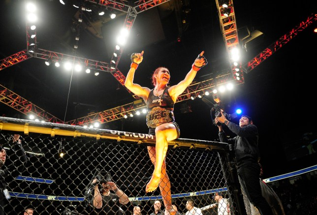 Cris Cyborg celebrates her victory by unamimous decision against Holly Holm
